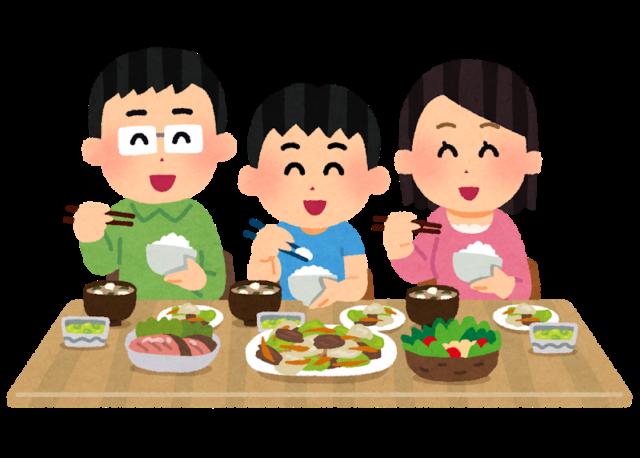 楽しそうに食事をする家族